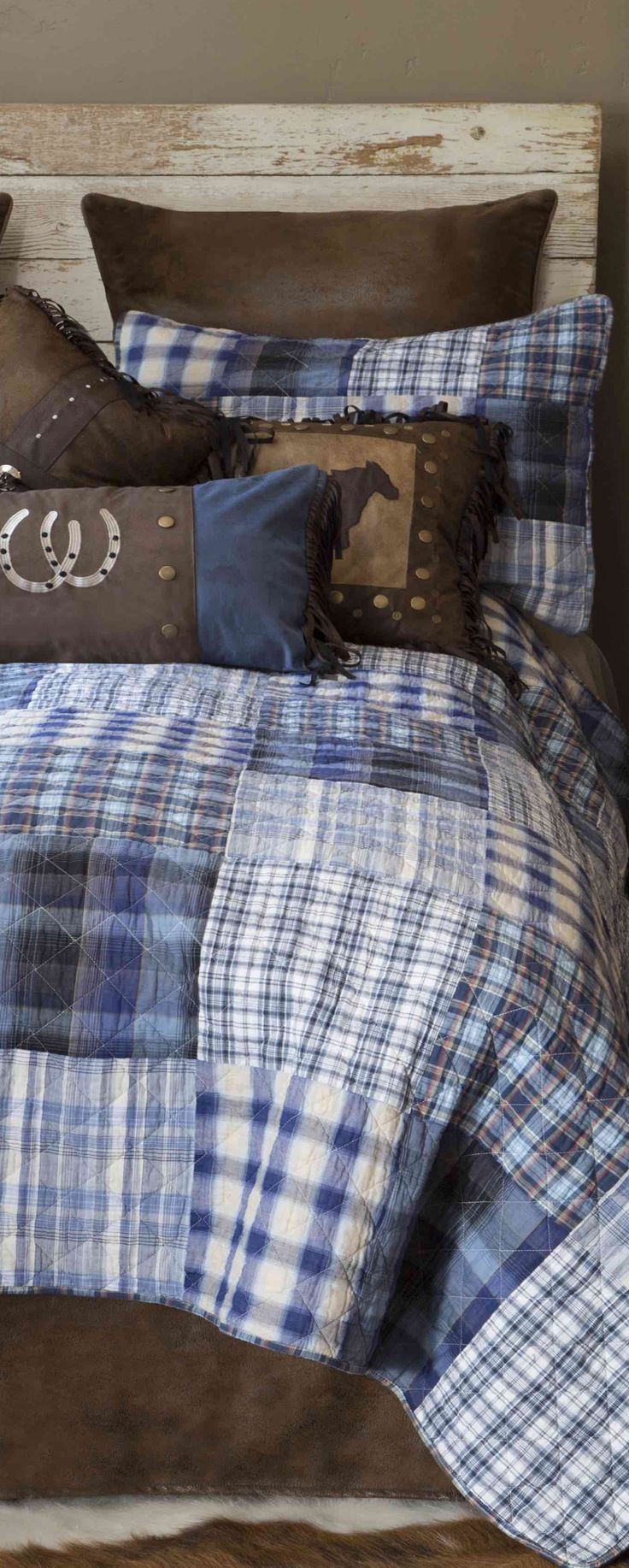 Western Bedding: Blue and white plaids reflect the beauty of an open sky on this patchwork cotton quilt bedding with rugged faux leather accents, rivets, conchos and embroidery.