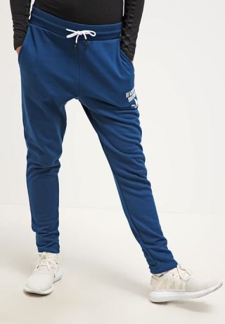Cumpara Pantaloni trening adidas conici cu tur lasat