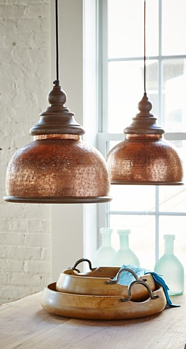 Lend an antique vibe to your décor with our brilliantly weathered Micah Pendant. As if it had spent decades hanging over a pool table, we've given our metal shade a richly textured copper finish. The shine of the shade is complemented by wood trim with a distressed matte finish.