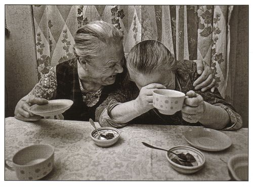 Two little old ladies laughing and sharing tea. I do hope I have a friend like this at this age. :)