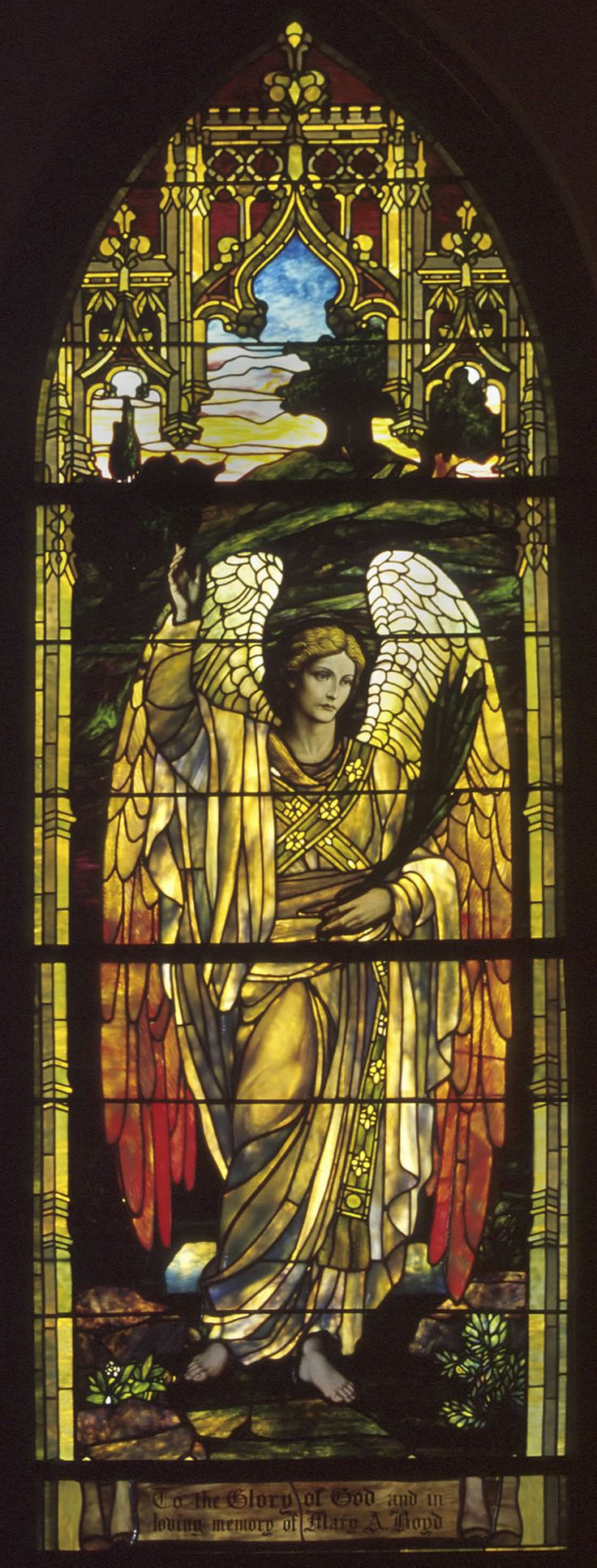 Grace-St Luke's Episcopal Church, Memphis.  The West Angel Window. Because of their exposures and how they caught the sun, they are referred to as the morning and evening angels. The Angel Windows are two of seven Tiffany windows.