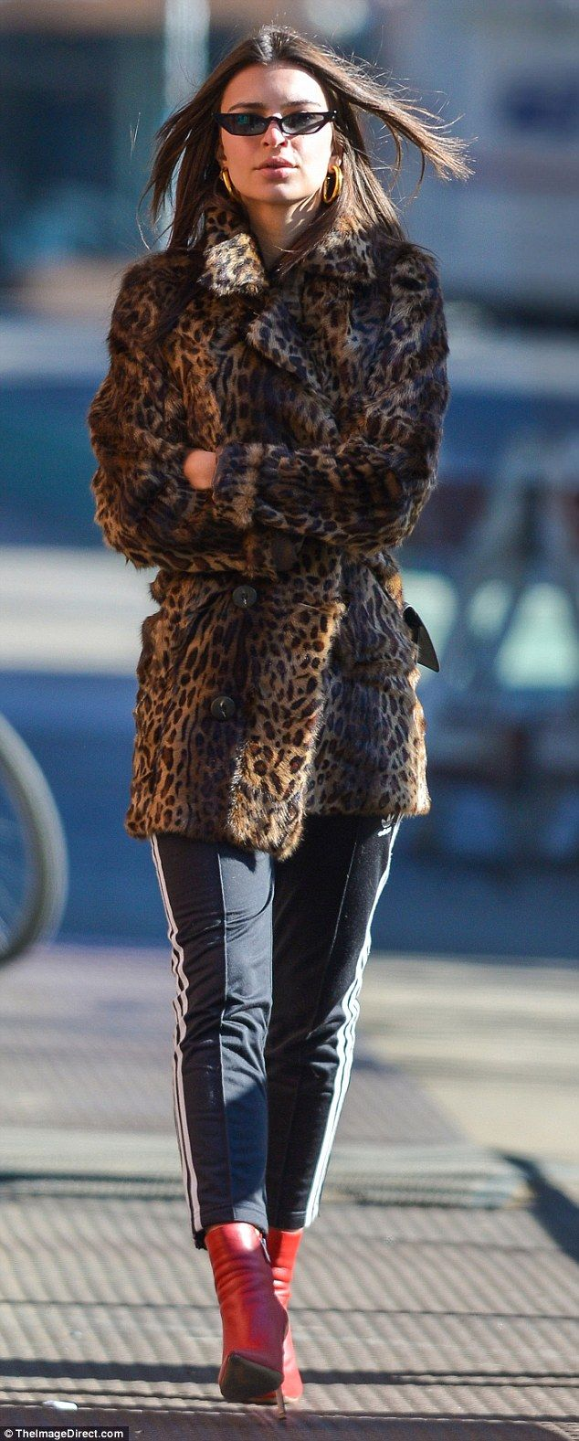 Chill out: Emily Ratajkowski walked around New York City in an animal print coat, Adidas t...