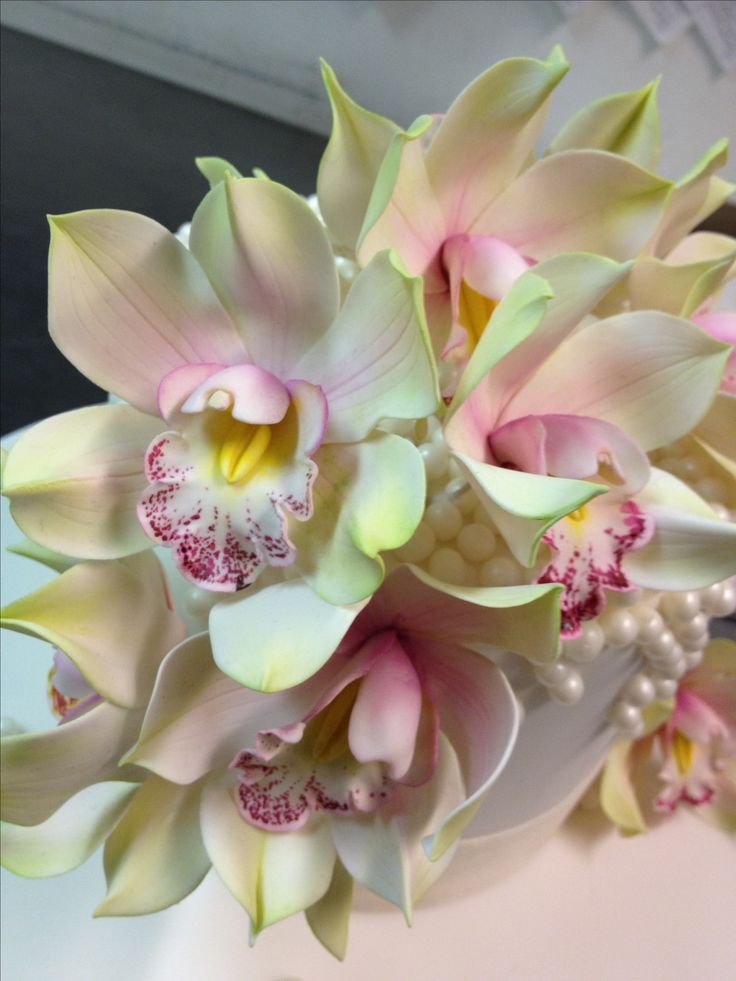 Sugar Cymbidium Orchids. NY, NY.I know these are sugar & gumpaste, but this works with porcelain too.