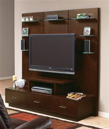 Includes audio video credenza and backwall. Includes TV mounting bracket. Contemporary style. Three large, two medium and small moveable frosted glass shelves.