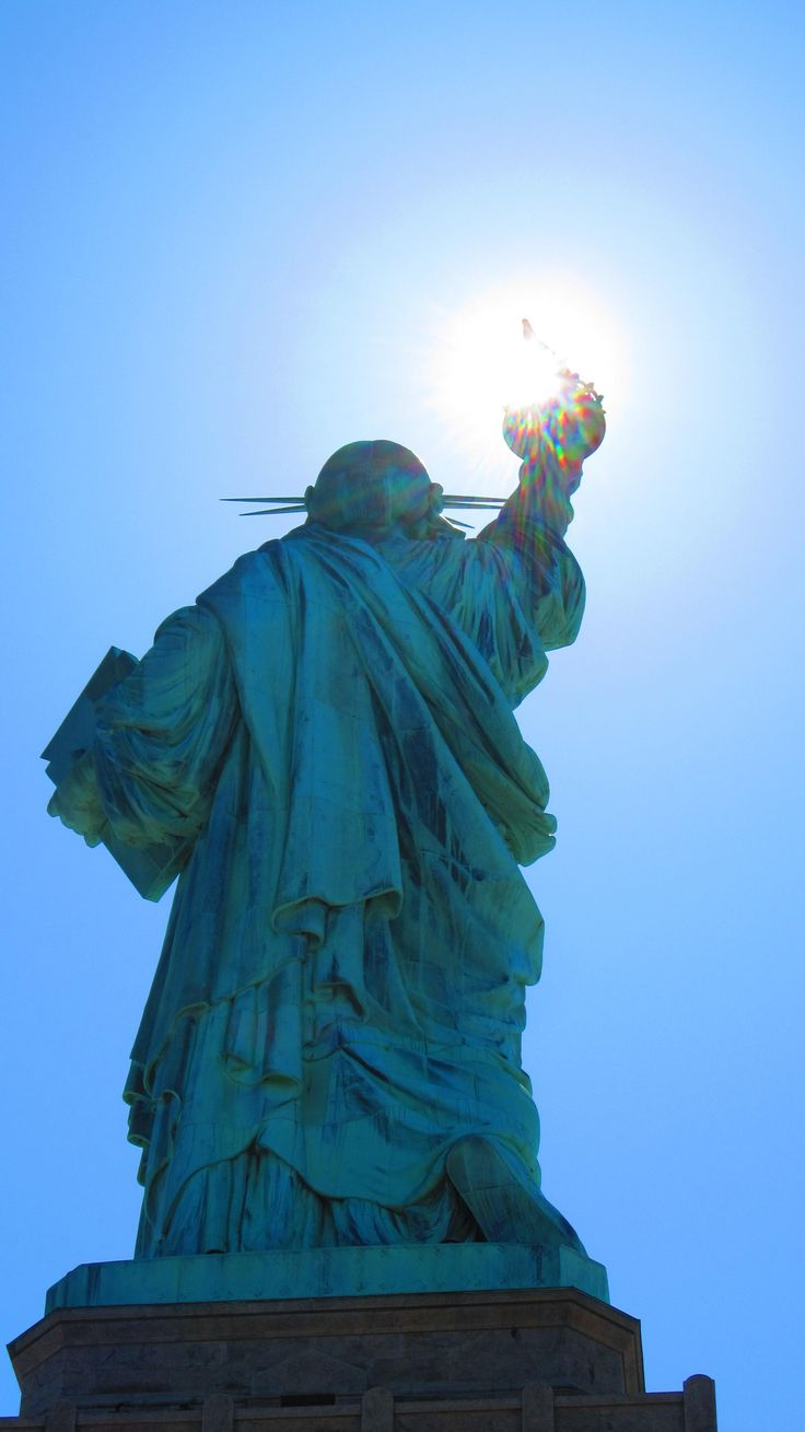 Statue of Liberty with torch glowing