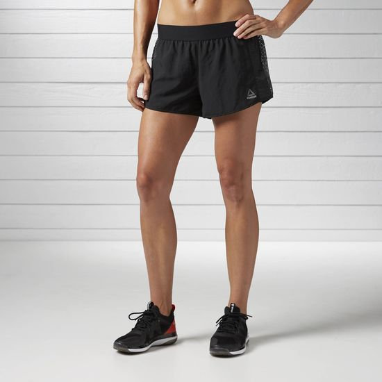 Reebok - LES MILLS Short - 3in: You bring motivation to each LES MILLS workout. Join forces with a training piece meant to reinforce your willingness to work. The outer short moves with you and looks stylish, while the inner brief adds coverage. When the beat heat ups, you stay cool thanks to mesh panels on the sides.