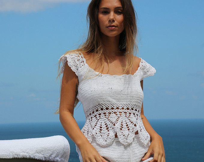 This stunning crochet tank top has beautiful diamond detail, frill shoulders that can be worn on or off the shoulders and drawstring waist. Perfect casual top to wear with your favourite shorts or styled with one of our crochet shorts to make a perfect set.  Features 100% cotton Handmade crochet Detailed diamond pattern Frill shoulder One size Cold Hand wash  wholesale Welcome  Please allow 1-2 weeks production time: M A D E ~ T O ~ O R D E R Estimated delivery for EMS Express Post : ✓ 5…