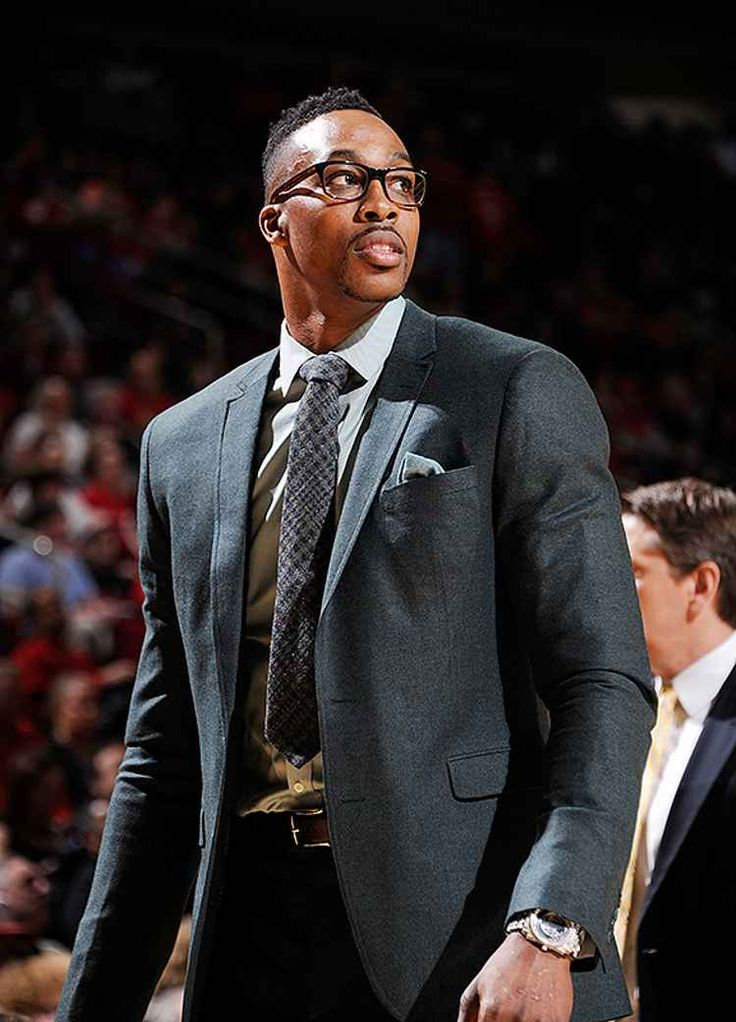 Dwight Howard of the Houston Rockets shows off eclectic suit collection while injured