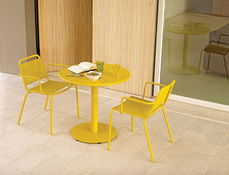 Nomad bistro dining setting in mustard by Gloster  http://www.coshliving.com.au/outdoor-brands/gloster/nomad/
