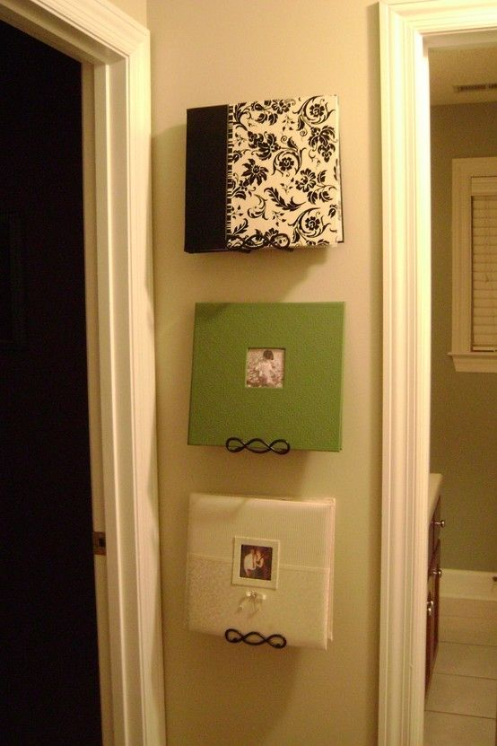 Pretty photo albums displayed on wall.