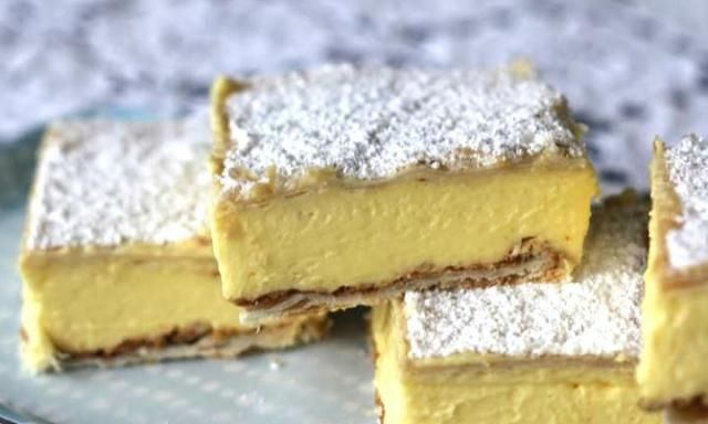 This creamy custard or vanilla slice recipe is so easy, even the kids will be able to make it - but they may need a little help with the oven. It has a delicious, thick custard centre and a crispy pastry top and bottom.