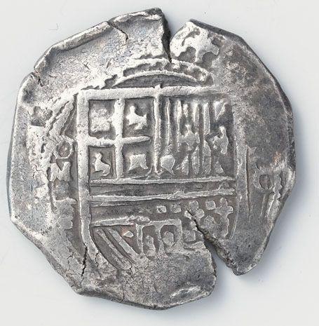 Acht realen. VZ: gekroond wapen. Links ervan de muntletters O, M en F, rechts de waarde-aanduiding VIII. KZ: wapen van Castilië en Léon in een achtpas. Omschrift (op VZ en vervolgd op KZ): 'PHILIPPVS DEI GRATIA HISPANIARVM ET INDIARVM REX (= Philips, bij de gratie Gods, koning van Spanje en Indië). 1555-1621