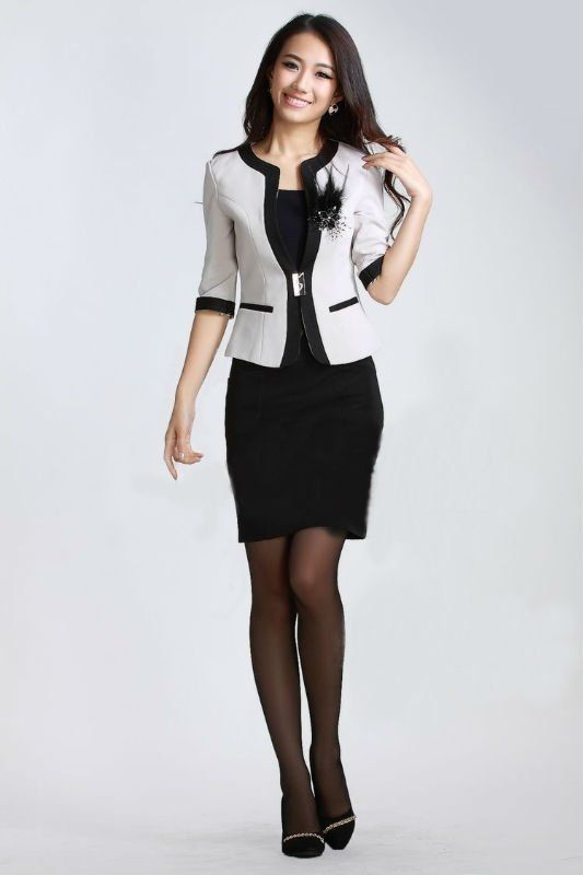 Love the sheath dress and stylish jacket.  Belt is cute, too.