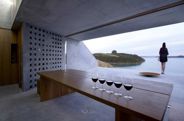 MAP Architects designed a wine cellar in the Bay of Islands of New Zealand. Restricted to 25m2 due to local planning regulations, and set in to the hill side to reduce the presence on the skyline, this simple building forms a calm backdrop to the scenery, intended to enhance the enjoyment of the environment, and wine tasting.