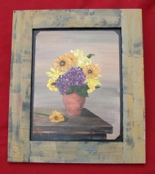 Still Life by Sheila Santiago.  Painted on a reclaimed cabinet door.  The frame is painted on in a crackled style.  This is a beautiful painting and there are many more paintings on many different surfaces at  www.sheilaspaintedcreations.com