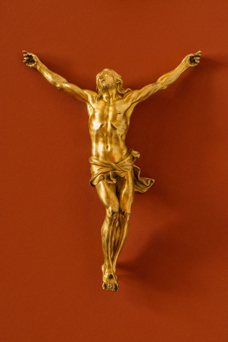 A beautiful and luminous statue of the crucifixion at the Bode Museum in Berlin, Germany.