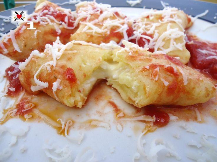 Tortelli di patate con mozzarella e sugo al pomodoro
