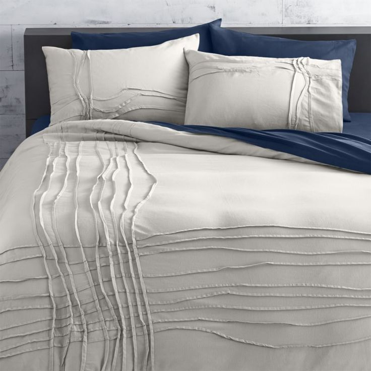 cb2.com http://www.cb2.com/twisted-silver- twisted silver grey king duvet monochromatic merge. Silver-grey sleepscape dreams up tone-on-tone texture. Woven of soft cotton/linen, flowing ribbons of fabric cross paths off-center in an organic ripple effect. Duvet reverses to solid silver grey. Duvet has non-slip corner ties and hidden button closure. Cotton/linen250 thread countDuvet cover has non-slip corner ties and hidden button closure; reverses to solid silver greyMachine wash; line dry.