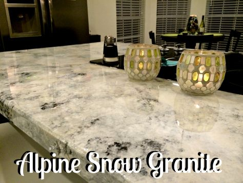 Gorgeous, reflective white granite This blog tells you step by step how to achieve a gorgeous granite look for less!! She used Envirotex Lite to seal the countertops and give them a hard clear sheen.