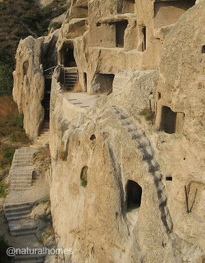 The caves homes of Guyaju (Guyaju meaning, ancient cliff dwelling) are about 90km northwest of Beijing, China. They were occupied during China's Tang Dynasty (AD 618-907). They were occupied about 1,100 years ago by the Xiyi people. The homes, some with stylish pillars of stone, are arranged in two village clusters supplied with fresh water from a natural spring. More at www.naturalhomes.org/timeline/guyaju.htm