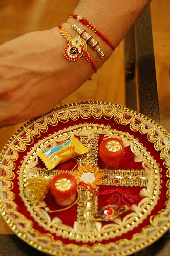 Rakhi A Hindu tradition where a sister ties the jeweled string bracelets around the brothers wrist, praying for his health and prosperity. In return, the brother promises to take care of his sister, as a father would.