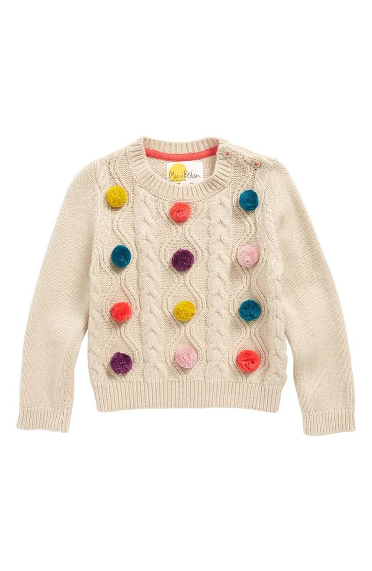 Colorful pompoms brighten up a charming cable-knit sweater in a cozy cotton blend.