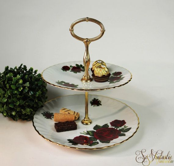 Lovely Shabby chic 2 tier cake stand by Rheinpfalz Hartporzellan, later Winterling. 60s vintage cake tray with 2 German porcelain plates, romantic red roses and green leaves pattern, scalopped and gold trimmed. Gold toned metal stand with an oval shaped handle at the top. Suitable for many festive occasions, such birthday, wedding, baby shower and Christmas. 2 tower serving stand of German china, in excellent condition. On offer by SoVintastic on Etsy;-)!