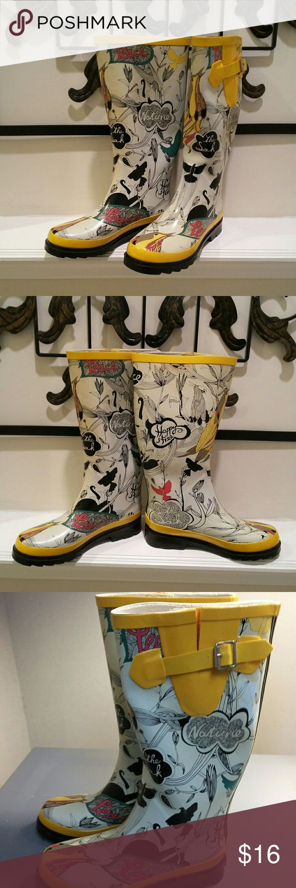 The Sakroots Wellington Boots White, Yellow and Red with Black Accents and a gripped sole. Side decorated with a yellow rubber strap Happy, peace, love, joy motifs printed on boot in black.  Pre Owned Some Scuffs and slight discoloration  One buckle is slightly damaged but these boots are still wearable. Use in Garden or a Rainy day or just for fun sense they are so cute. Size 6 Sakroots  Shoes Winter & Rain Boots