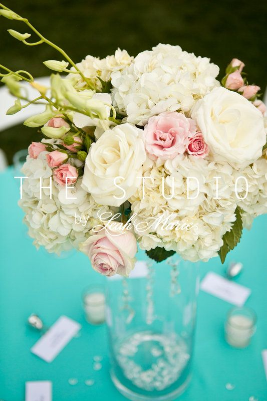 White with pink accents, hydrangea and rose centerpiece