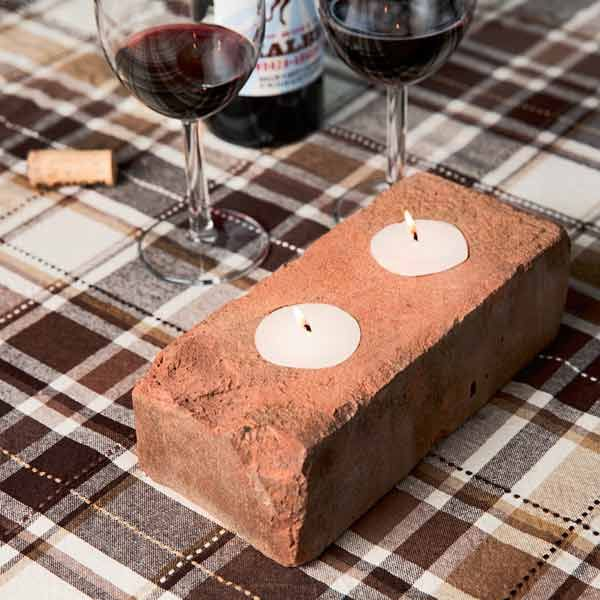 Craft a tea-light holder from a repurposed brick by using a hole saw with a 1½-inch carbide-tipped masonry bit. Drill two holes about ½ inch into a brick, just deep enough for a standard tea light to rest. Place a candle in each opening. Bonus: Outdoors, the brick will also anchor a tablecloth on a windy day. | Photo: Ian Spanier | thisoldhouse.com