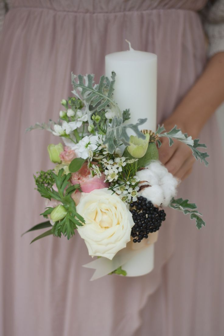 Dusty miller, rose and viburnum decoration for candle.