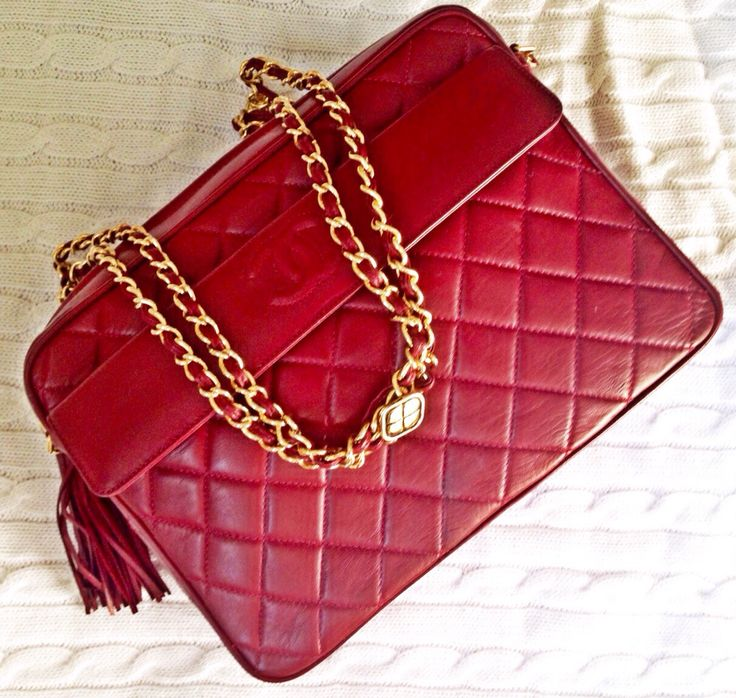 Vintage 1980s Chanel quilted red leather bag with logo, tassel and gold chain straps