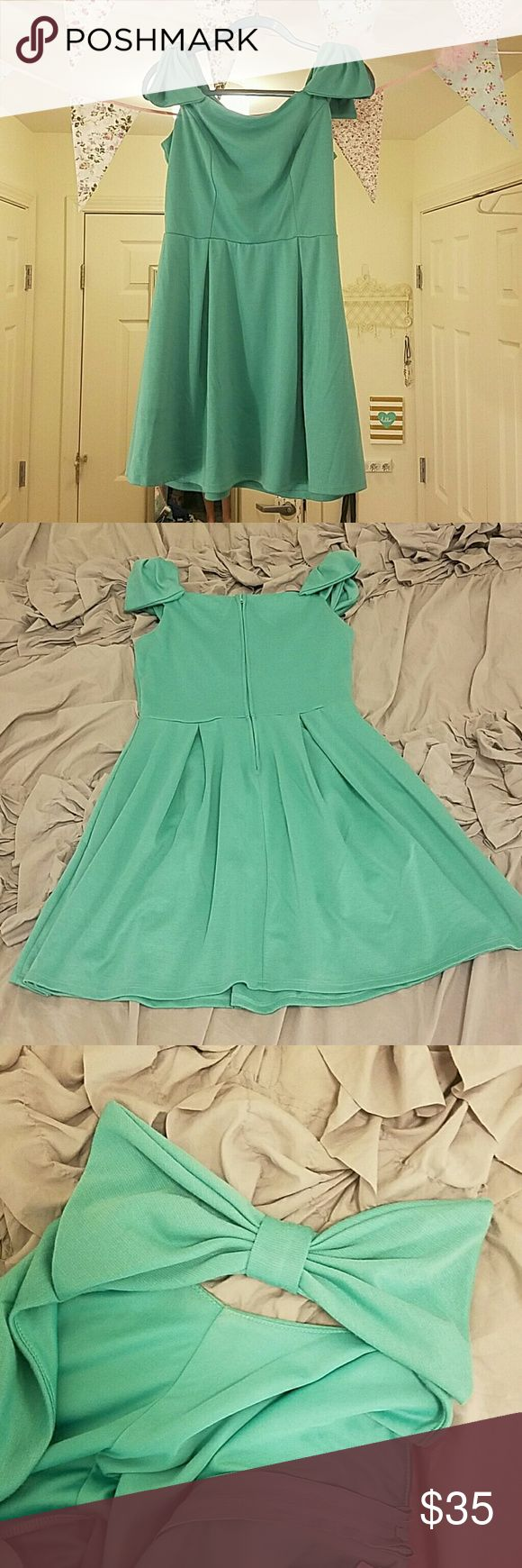 Adorable teal/green dress with bows on shoulders Super sweet teal fit and flare dress with bows on shoulders.  Very kate spade like style (note: not kate spade though). Pleats in front, zipper in back. Perfect for a festive St. Patrick's day outfit. Tag says large but fits an 8 with a 34D bra size well.  In excellent used condition and originally purchased from Francesca's.  Only possible flaw is a light area shown in last picture but I think this is just part for the heathered fabric. kate…