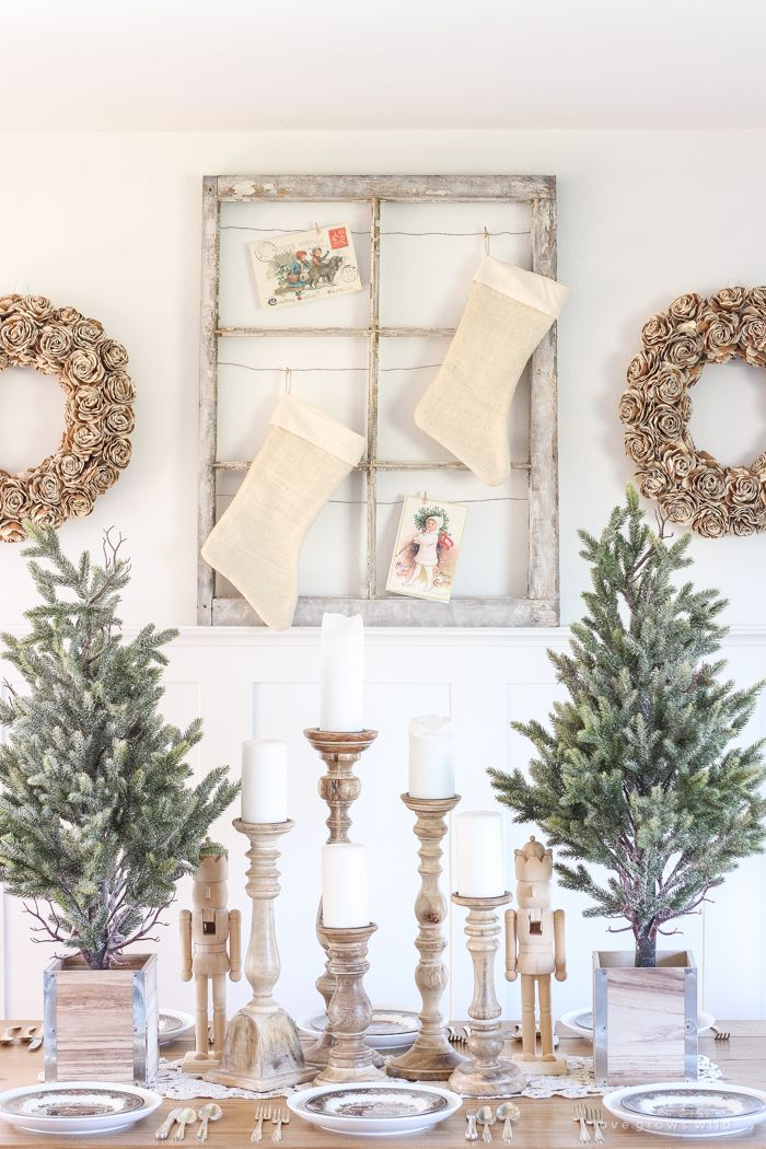 A Beautiful Farmhouse Table Decorated For The Holidays