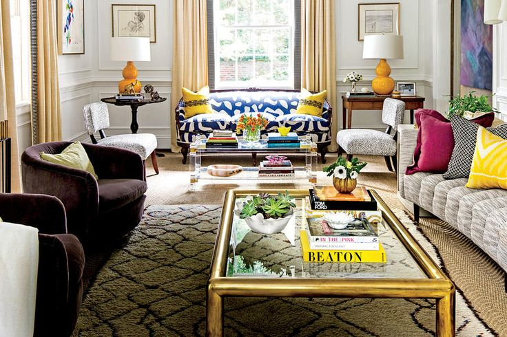 This living room blends modern and traditional with the help of a bold fabric choice
