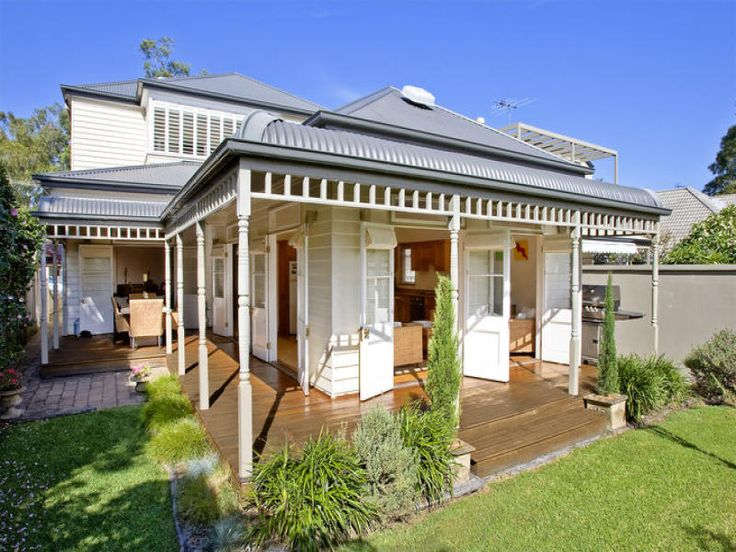 Grey Colorbond roof with bullnose verandah. I like the way each French door opens out onto the wraparound verandah. #roofing #deck #doors #verandah