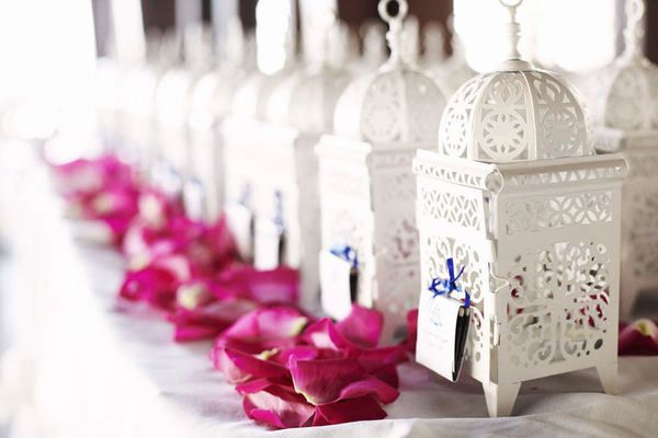Our Casablanca Lanterns are a creative way to distribute seating cards at an outdoor wedding reception.