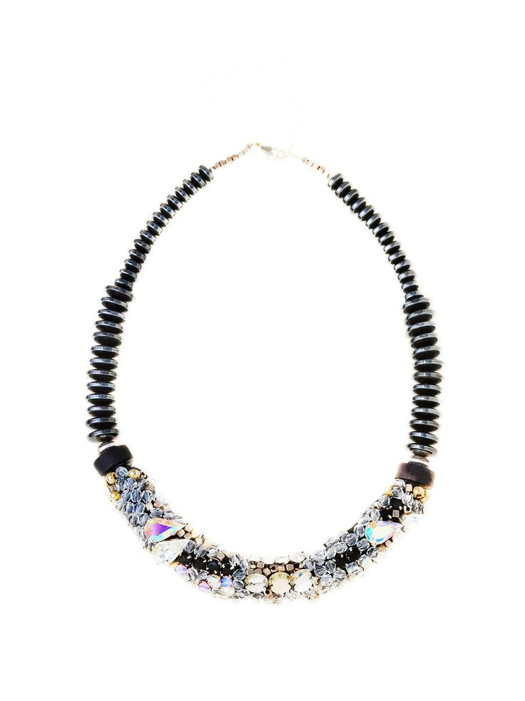 RIENNE Mona Necklace from Designrs.co   With a glimmering array of crystals, semi-precious stone (hematit), metal beads and glass beads, this necklace will become your signature sparkling statement.