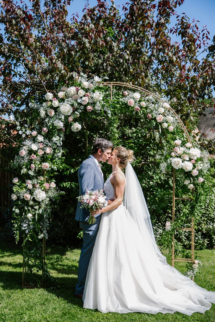 Floral Arch | Victoria Williamson Team GB Cyclist Wedding At Southwood Hall Norfolk Bride Wears Sassi Holford Images By Katherine Ashdown Photography
