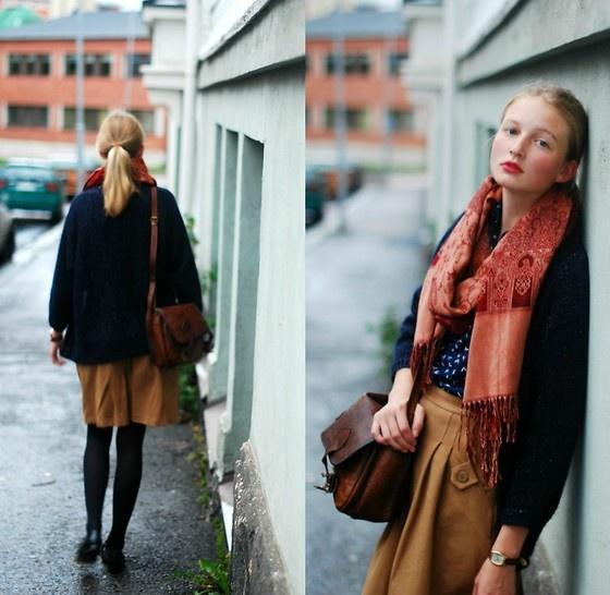 color story. Tan / brown skort , black tights,black shoes, navy cardigan, blue top,pink scarf