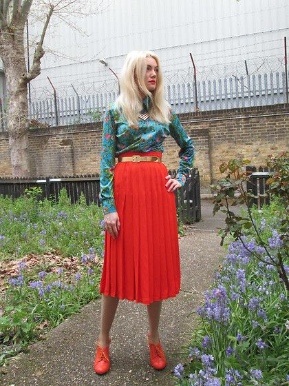 Get this look: http://lb.nu/look/8192063  More looks by Roxanne Rokii: http://lb.nu/roxannerokii  Items in this look:  Rokii Gold Necklace 2015, Vintage Turquoise 1970's Top, Vintage Gold Belt 1970's, Windsmor Orange Pleated Skirt C1990, Office Orange Patent Brogue Shoes 2011   #rokii #roxm #fashion #clothing #style #look #stylist #ootd #mystyle