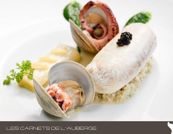 Filet de dorade poché, poireaux confits au citron, pieuvre et palourdes, quinoa à la noix de coco  Photo © Vadim Daniel