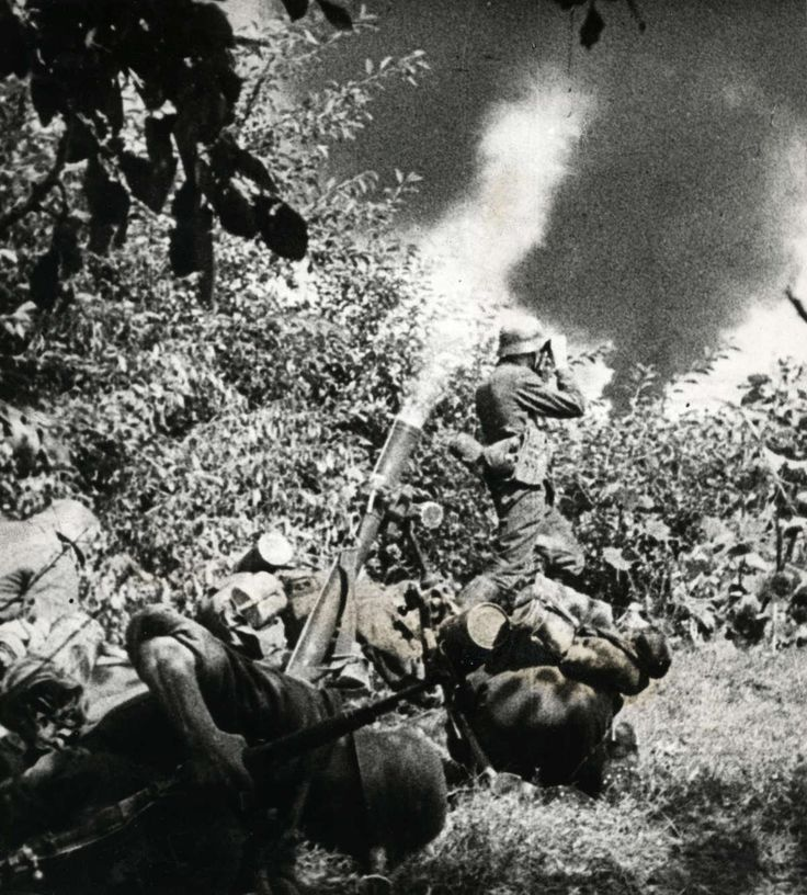 German soldiers fire a mortar on Soviet positions during Operation Barbarossa, Soviet Union. 1941
