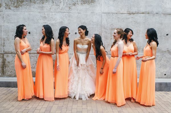 orange bridesmaid dresses, photo by Sunny 16 Photography http://ruffledblog.com/modern-austin-wedding-with-a-playful-twist #bridesmaids #bridesmaiddress