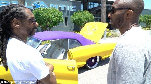Rapper Snoop Dogg (left) gave retired Lakers star Kobe Bryant (right) a Lakers-themed convertible as a retirement gift