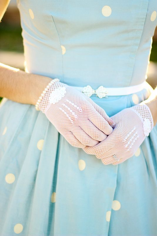 A very classic vintage look with the delicate white gloves and the vintage style blue white polka dot dress.