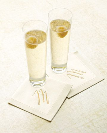 Champagne cocktails with golden raspberries