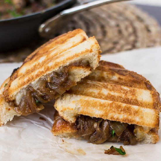 Caramelized onion and baby bella mushrooms with provolone cheese in a buttery panini melt. Vegetarian and vegan friendly!