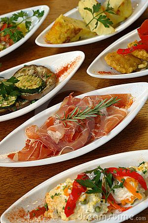 Keep food simple; hot/cold buffets work well; and allow your guests to try a little bit of everything as and when they wish! Choose the Euro entrants home style dishes... Spanish tapas shown here is always a winner!!!