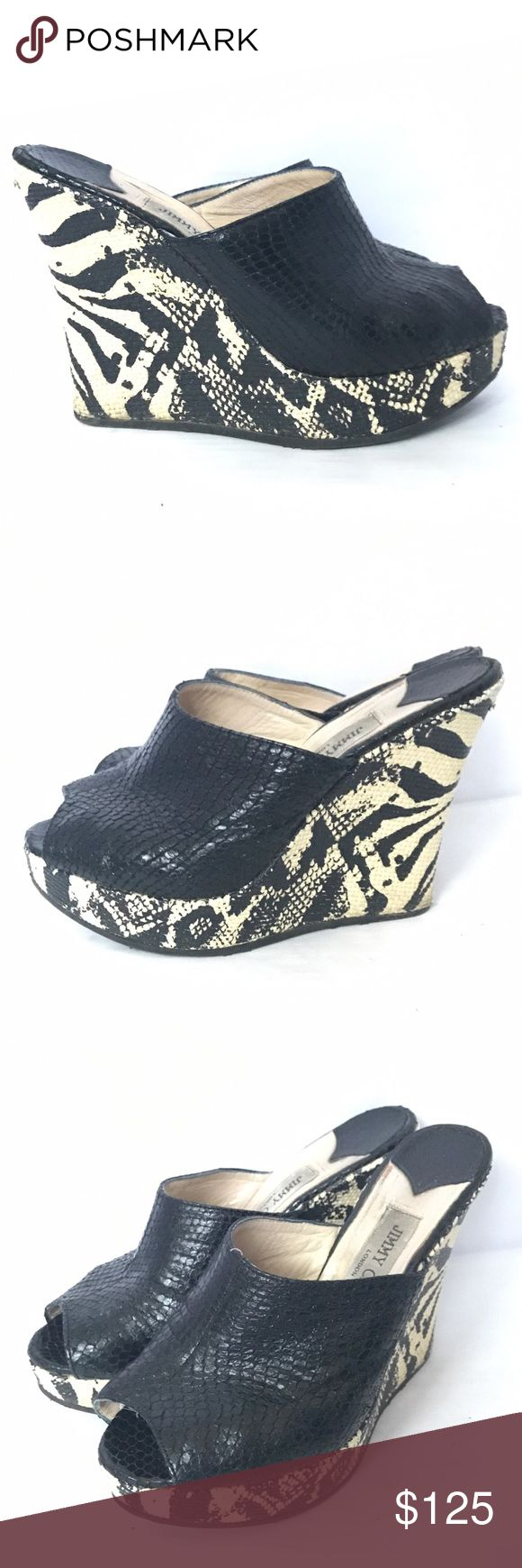 Jimmy Choo Snakeskin Wedge Black Zebra Heels Jimmy Choo Snakeskin Embossed Wedge Mules Black Zebra Heels Size 38 . Wedge heel measures approximately 125mm/ 5 inches with a 25mm/ 1 inch platform. Jimmy Choo Black snake-effect leather, animal-print cream raffia. Gripped rubber sole. Designer color: Black Zebra. Size EU 38 US 8 . Shows some wear but still in very good condition. Jimmy Choo Shoes Wedges